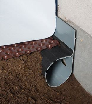 Closeup of a crawl space drainage system installed in Webster